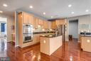 Gourmet open kitchen with stainless. - 21584 BURNT HICKORY CT, BROADLANDS