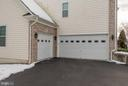 3-car garage with mudroom into the home. - 21584 BURNT HICKORY CT, BROADLANDS