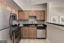 Kitchen with LOADS of cabinets! - 1001 N RANDOLPH ST #106, ARLINGTON