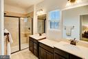 Luxurious master bath with spa shower - 22314 FOUNDATION DR, ASHBURN