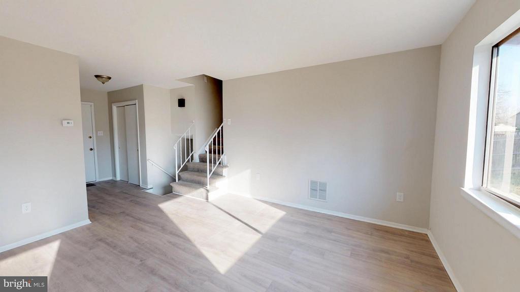New Flooring frames this living room dining room - 8807 CRANDALL RD, LANHAM