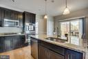 Espresso cabinets, granite, & stainless steel! - 54 COLEMANS MILL DR, FREDERICKSBURG