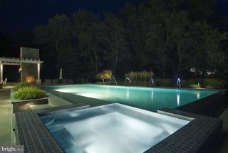 Night view of the pool & spa - 1208 SOUTHBREEZE LN, ANNAPOLIS
