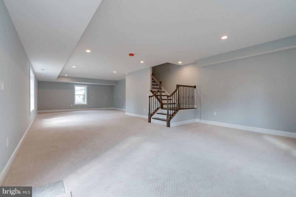 Generous lower level REC/MEDIA rooms. - 8733 POHICK RD, SPRINGFIELD