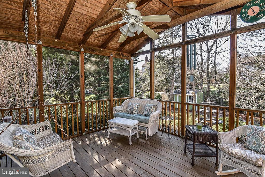 Enjoy the year round blooms from the porch - 1616 N HOWARD ST, ALEXANDRIA