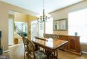 Elegant dining room with hardwood floors - 3704 THOMASSON CROSSING DR, TRIANGLE