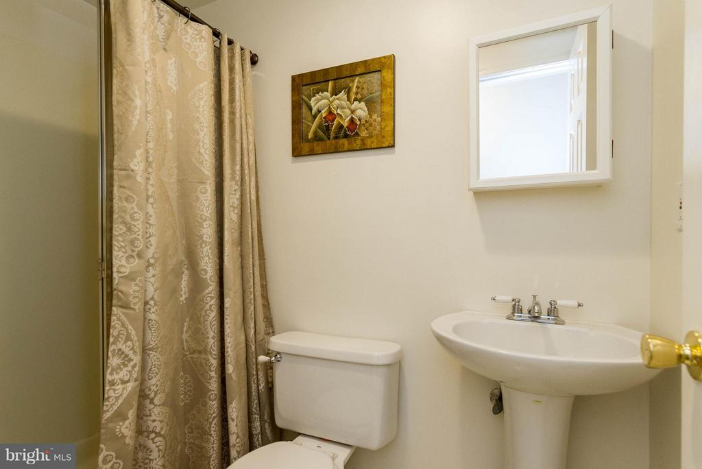 Full bath conveniently located in Basement - 3704 THOMASSON CROSSING DR, TRIANGLE