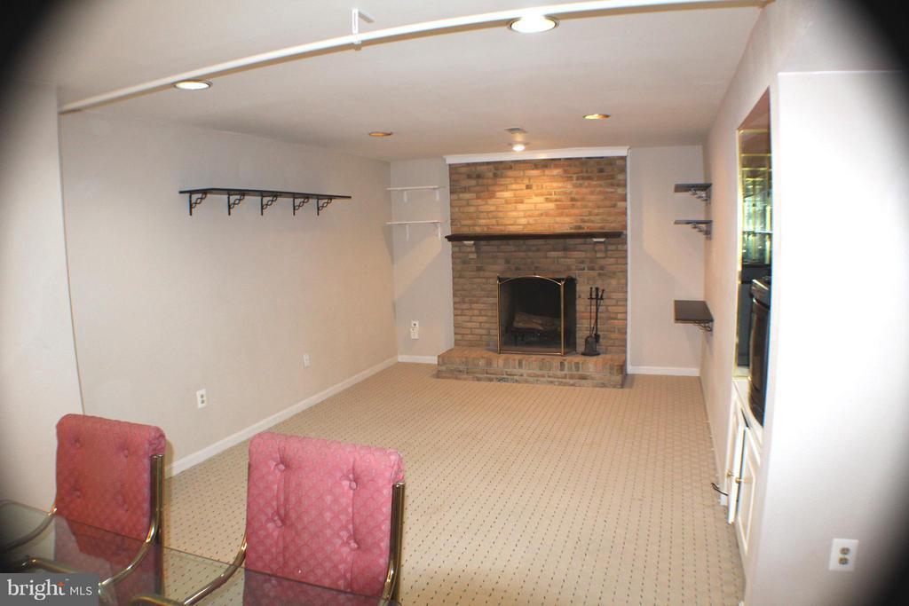 Lower Level Family Room w/Fireplace - 6606 FORSYTHIA ST, SPRINGFIELD
