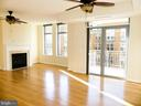 Living room and patio door. - 11990 MARKET ST #215, RESTON