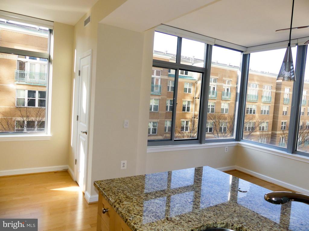 Kitchen and food and drink entertaining area. - 11990 MARKET ST #215, RESTON