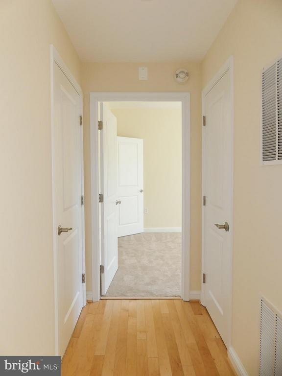 Hall to number two bedroom. - 11990 MARKET ST #215, RESTON