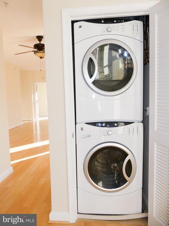 Laundry closet with units. - 11990 MARKET ST #215, RESTON