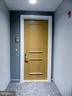 Subject unit front door. - 11990 MARKET ST #215, RESTON