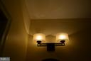 Lower level full bath light fixture. - 1724 BAY ST SE, WASHINGTON