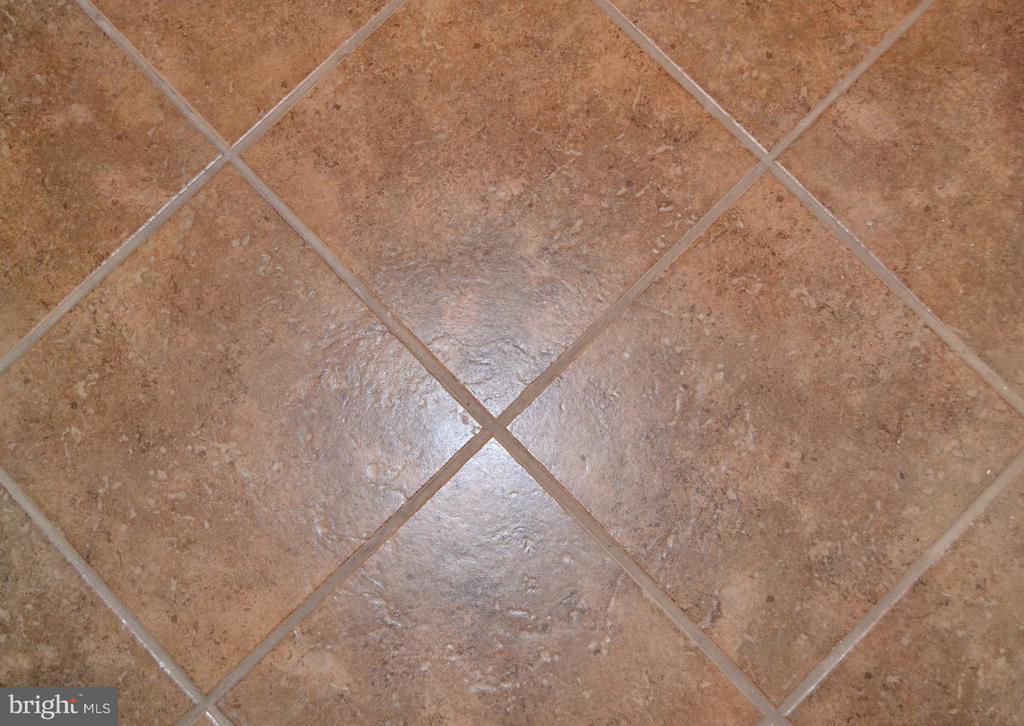 Lower level bath, ceramic tile. - 1724 BAY ST SE, WASHINGTON