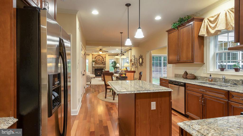 Kitchen open to breakfast~nook and family room - 101 FEATHERDALE CIR, FAYETTEVILLE