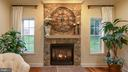 Gas fireplace with stone surround - 101 FEATHERDALE CIR, FAYETTEVILLE