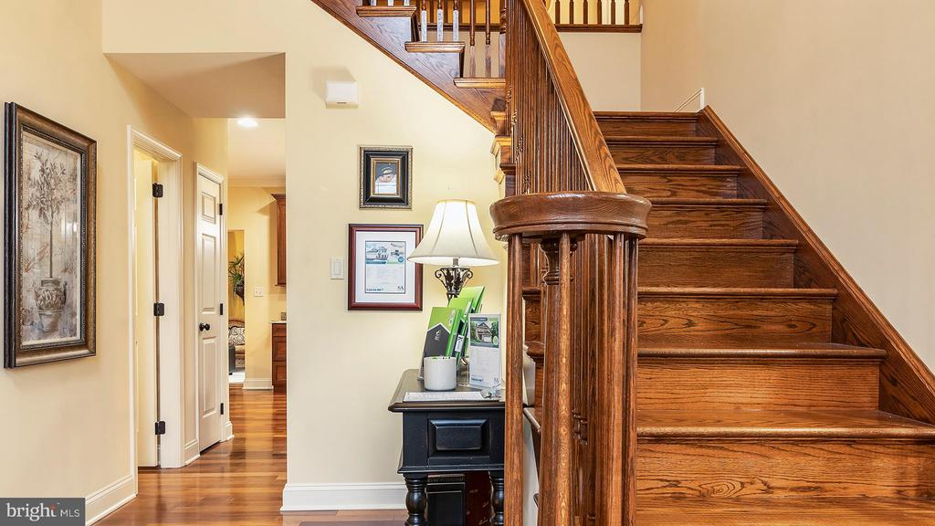 Curved railing accents the wood staircase - 101 FEATHERDALE CIR, FAYETTEVILLE