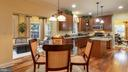 Kitchen and breakfast nook opens to morning room - 101 FEATHERDALE CIR, FAYETTEVILLE