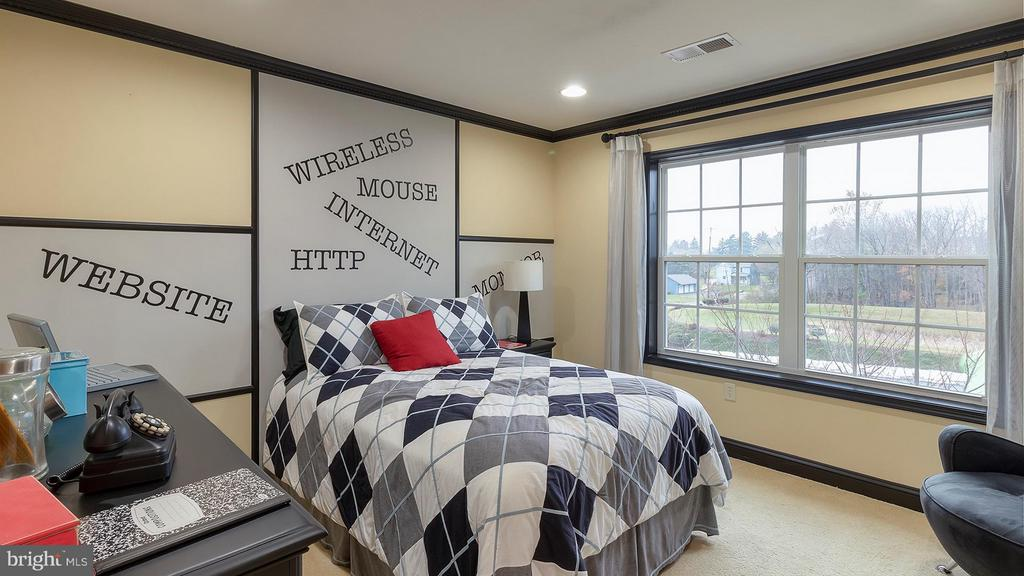 Bedroom 3 with double window and recessed lighting - 101 FEATHERDALE CIR, FAYETTEVILLE