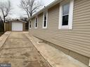 Side View of Home- Garage & Carport Parking - 7105 FRESNO ST, CAPITOL HEIGHTS