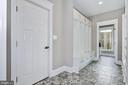 Step out of the garage and into this large mudroom - 5601 WILLIAMSBURG BLVD, ARLINGTON