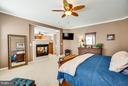 Master Bedroom with Dual View Gas Fireplace - 1019 E KENSINGTON CIR, FREDERICKSBURG