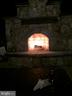 Outdoor fireplace lit at night - 1019 E KENSINGTON CIR, FREDERICKSBURG