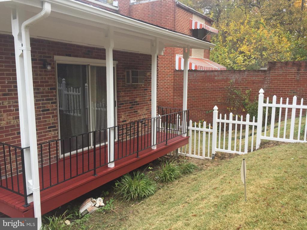 Back of the home with a sliding glass doors - 4007 AMES ST NE, WASHINGTON