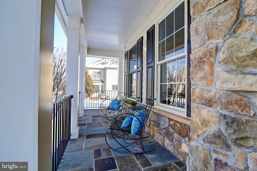 Flagstone front porch - 44181 RIVERPOINT DR, LEESBURG