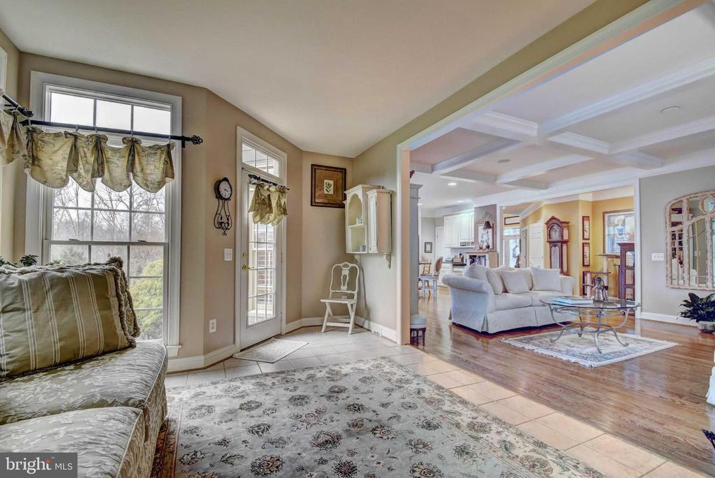 sunroom opens to family and kitchen - 4424 TUSCANY CT, WOODBRIDGE