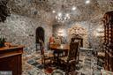 Stone wine grotto with impressive mantle - 11408 HIGHLAND FARM CT, POTOMAC