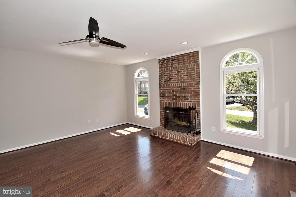 Family Room features woodburning fireplace - 46441 MONTGOMERY PL, STERLING