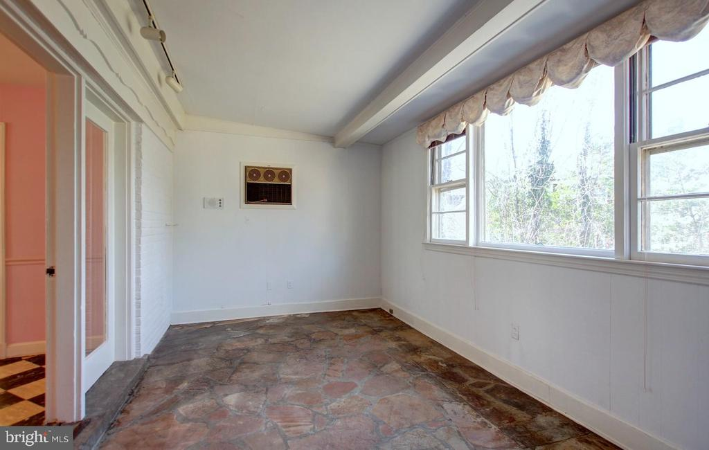 Den with stone floor - 4206 COLLEGE HEIGHTS DR, UNIVERSITY PARK