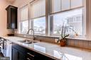 Sun-filled kitchen with designer window treatments - 41621 WHITE YARROW CT, ASHBURN