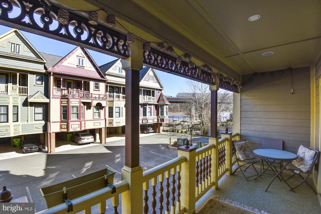 Relaxing covered porch with water views. - 217 MILL ST, OCCOQUAN
