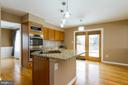Kitchen Island and Double Ovens - 9310 E CARONDELET DR, MANASSAS PARK