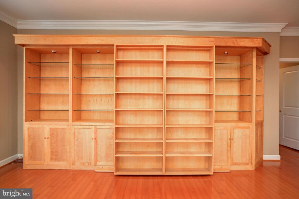 Built-in Sliding Bookshelves  to accommodate TV - 440 BELMONT BAY DR #104, WOODBRIDGE