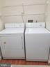 Main Floor Laundry with Custom Built In Shelving - 5 DEEP RUN RD, FREDERICKSBURG