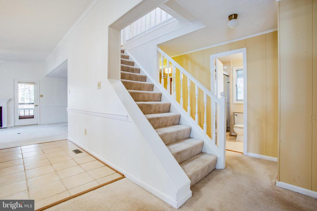 Stairs leading to the Upper Level off kitchen. - 232 BIRCHSIDE CIR, LOCUST GROVE