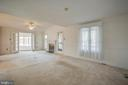 Living Room with Gas Fireplace and Dining area. - 232 BIRCHSIDE CIR, LOCUST GROVE