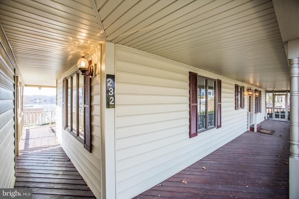 Front Porch - leading to garage and backyard. - 232 BIRCHSIDE CIR, LOCUST GROVE