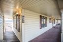 Front Porch - leading to garage and backyard. - 232 BIRCHSIDE CIR, LOCUST GROVE