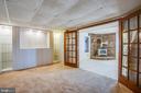 Den with Built-In Shelving in the Lower Level. - 232 BIRCHSIDE CIR, LOCUST GROVE
