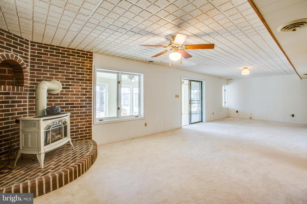 Propane  Stove in the LL Family Room. - 232 BIRCHSIDE CIR, LOCUST GROVE