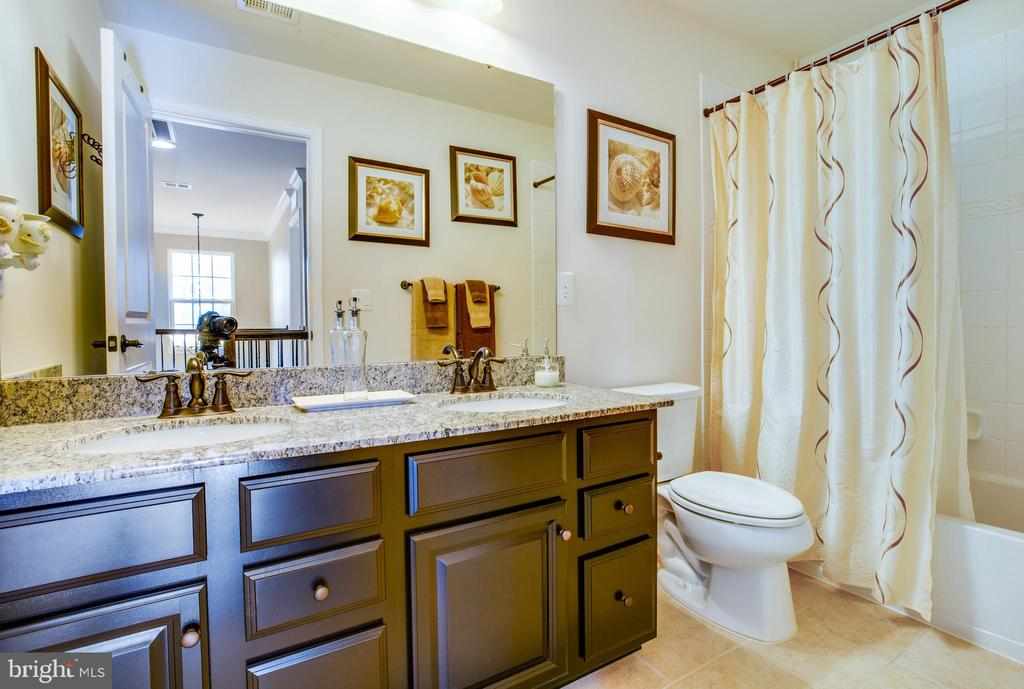 Hall bath with double vanities and tile floors - 98 GENEVIEVE CT, FREDERICKSBURG