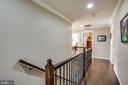 Wood floors and wrought iron railing in upper hall - 98 GENEVIEVE CT, FREDERICKSBURG