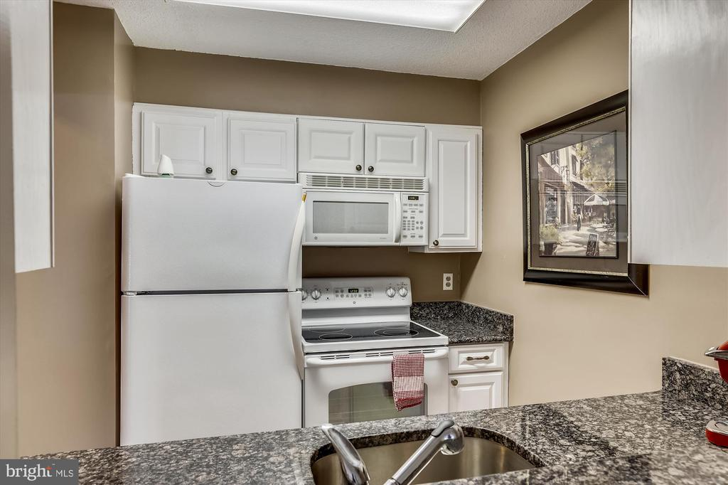 Bright kitchen with white appliances and cabinets - 2100 LEE HWY #114, ARLINGTON