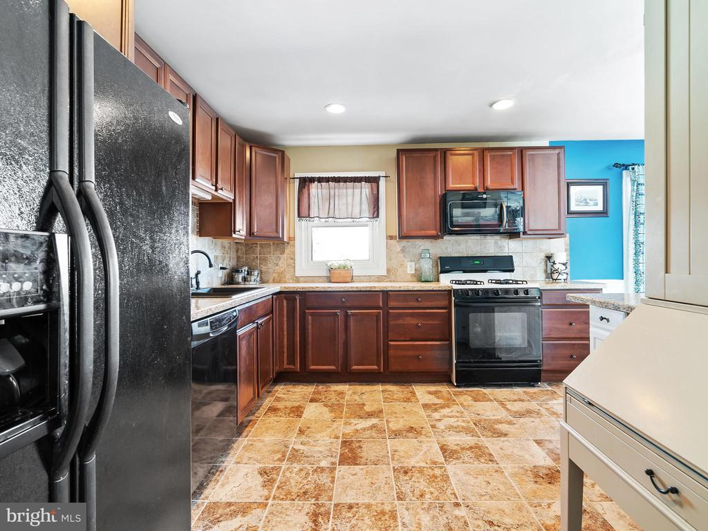 Kitchen from the Main Hall - 9716 LAFAYETTE AVE, MANASSAS