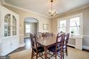 Dining room with built-in corner wood cabinet - 115 W MAPLE ST, ALEXANDRIA